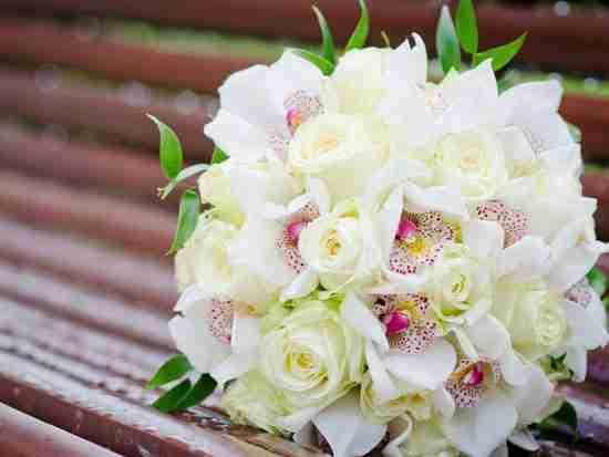 新娘手捧花用�r花�是假花好